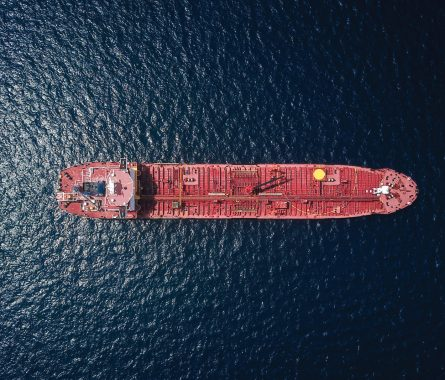 aerial view of freight shipping boat on a body of water